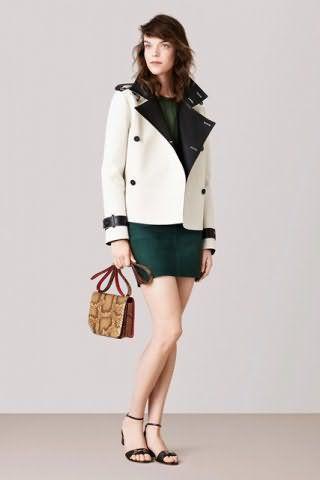 Двубортный пиджак белого цвета оттенка слоновой кости с черной отделкой из коллекции Bally.