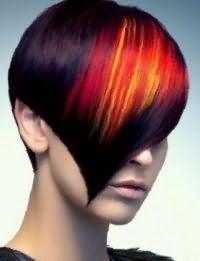 Стильное колорирование красного, желтого и оранжевого цветов, плавно переходящих друг в друга, великолепно смотрится на волосах темно-каштанового оттенка в короткой асимметричной стрижке с удлиненной челкой