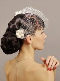Свадебная прическа с фатой на длинные волосы.