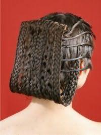Идея необычной прически из кос