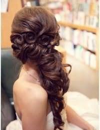 Свадебная прическа коса на бок.