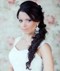 Прическа коса на бок для невесты.